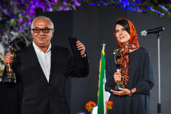 "This combo shows Farid Sajjad-Hosseini holding the supporting actor award for his role in ""The Salesman"" and Leila Hatami with the best actress award for ""Subdued"" during the 19th Iran Cinema Celebrat"