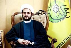 الشيخ  أكرم كعبي يقلد الشيخ حمود درع المقاومة العراقية