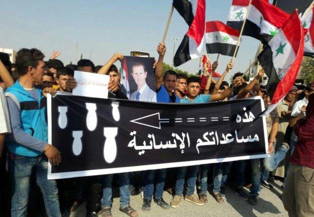 Protest in al-Sfeira condemning US-led coalition's massacres against civilians