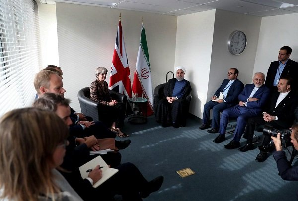 Rouhani, May call for closer coop. on bilateral, regional issues