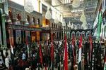 تعویض پرچم گنبد حرم امام حسین(ع) به مناسبت محرم