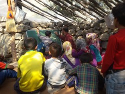 "Aziz Mohammadi is seen teaching nomad schoolchildren in a scene from ""The Lonely Road""."