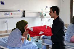 پرچم گنبد امام حسین(ع) بر بالین بیماران قزوین