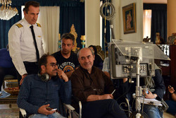 "Kamal Tabrizi (C) directs a scene from the TV series ""Motherland""."