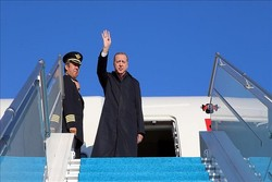 Turkey's Erdogan lands in Tehran