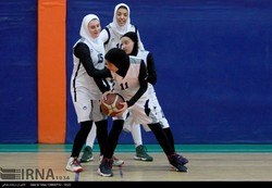 Iranian girls at basketball training pitch