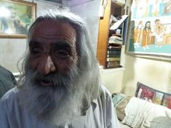 حسین محمودی معروف به اژدر نقاش روی پرده