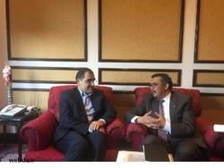 Hassan Qazizadeh Hashemi (L) and Tedros Adhanom Ghebreyesus