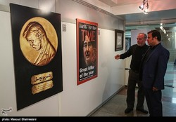 Art enthusiasts visit an international poster exhibition on the massacre of Muslims in Myanmar at the Art Bureau in Tehran on October 10, 2017. (Tasnim/Masud Shahrestani)