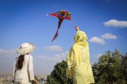 Children fly kites in Hamedan