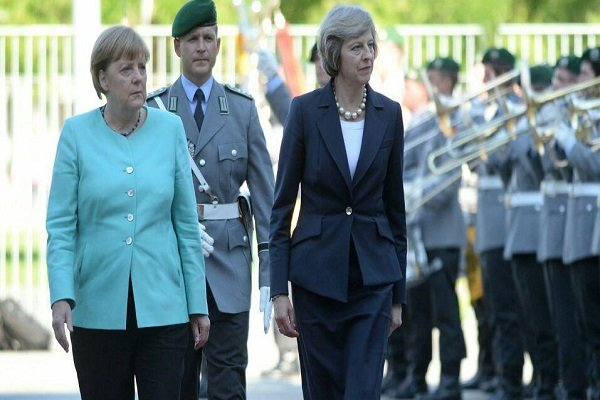 May, Merkel re-voice commitment to Iran N-deal