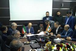 IRIB director Abdol-Ali Ali-Asgari and Hezbollah senior leader Hashim Safi al-Din sign a memorandum of understanding at Hezbollah's Al-Manar television station in Beirut.