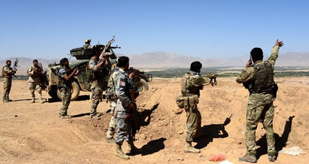 14 militants give up fighting in northern Afghan province