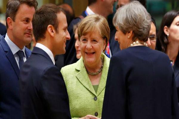 Merkel endorses Macron's EU military plan