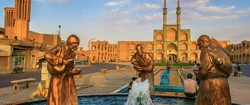 A file photo shows life-size sculptures standing in front of the three-story Amir Chakhmaq Complex in Yazd, central Iran.