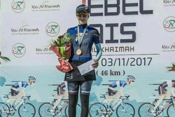 Female cyclist atop Jebel Jais Challenge