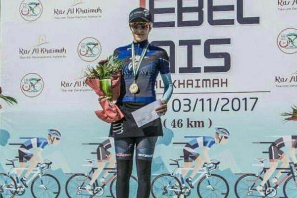 Female cyclist atop Jebel Jais Challenge