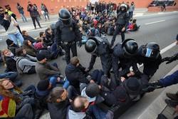 تجدد الاشتباكات بين متظاهرين وقوات أمن اسبانيا في اقليم كتالونيا