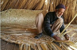 An Iranian artisan makes a piece of mat board.