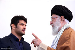 Leader receives Iranian hero athlete Alireza Karimi
