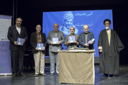 """Scholars hold copies of """"Shahriar and the Revolution of Nation"""" in a ceremony held by Tehran's Niavaran Cultural Center on December 10, 2017 to unveil the book."""