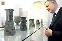 British Museum Director Hartwig Fischer looks at ancient vessels during his visit to the National Museum of Iran on December 19, 2017.