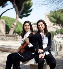 Italian musician sisters Natascia Gazzana (L) and Raffaella Gazzana