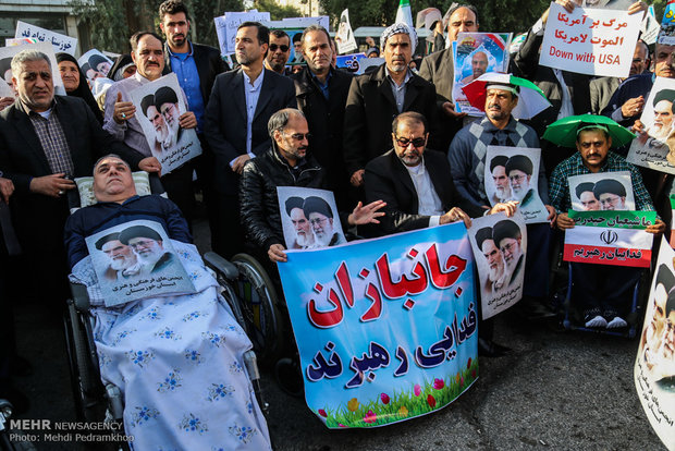 Iranians march streets to denounce riots