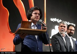 """Booklessness"" author Mohammadreza Sharafi-Khabushan (L) speaks after accepting the prize for best novel during the 10th Jalal Al-e Ahmad Literary Awards at Tehran's Vahdat Hall on January 6, 2018."