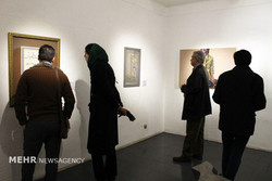 Art enthusiasts visit an exhibition of works by a group of Iranian art elites at Tehran's Farda Gallery on January 12, 2018.