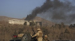 Smokes rises from the Intercontinental Hotel after an attack in Kabul, Afghanistan, Sun. Jan. 21, 2018. Gunmen stormed the hotel in the Afghan capital on Saturday evening, triggering a shootout with s