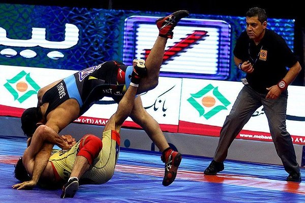 Iranian referees' performance at Takhti  Cup  approved by UWW