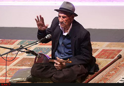 Iranian tambur virtuoso Seyyed Qadamyar Hosseini performs in an undated photo.
