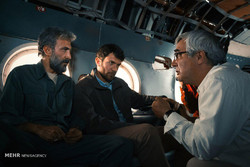 "Ebrahim Hatamikia (R) directs Hadi Hejazifar (L) and Babak Hamidian in a scene from ""At Damascus Time""."