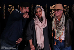 "Director Kambuzia Partovi (R) and cast members Nasrin Moradi (C) and Saeid Aqakhani pose during a photocall for ""Truck"" at the Fajr Film Festival in Tehran on February 2, 2018. (Mehr/Mohammadreza Abba"