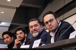 "Director Mohammad-Hossein Mahdavian (1st R) and producer Mahmud Razavi (2nd R) and their colleagues attend a press conference about their latest film ""Lottery"" during the 36th Fajr Film Festival at Te"