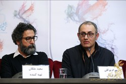 "Producer Saeid Malekan (L) and director Bahram Tavakkoli attend a press conference for their film ""The Lost Strait"" during the 36th Fajr Film Festival at Tehran Mellat Cineplex on February 7, 2018. (F"