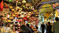 Travelers visit Istanbul's Grand Bazaar that is one of the largest and oldest covered markets in the worl