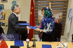 Negar Gerami, WFP Representative and Country Director in Iran (R), and Chinese Ambassador to Iran Pang Sen