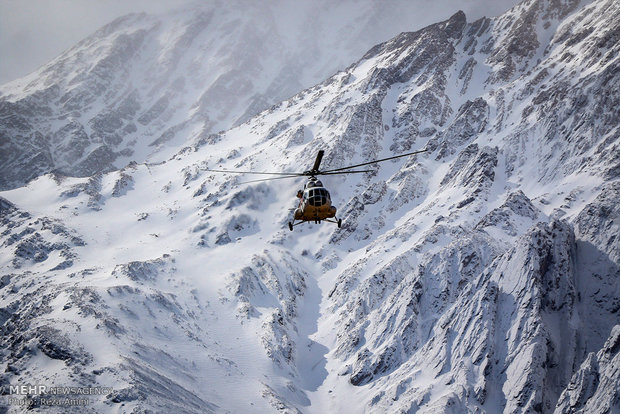 A helicopter searching for the wreckage of the plane