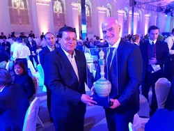 Mohammadreza Saket, the secretary general of the Iranian Football Federation, presents handicrafts to FIFA President Gianni Infantino in an undated photo.