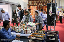 People visit a national crafts exhibition in Tehran, August 24, 2017.