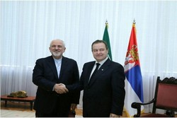 FM Zarif arrives in Belgrade, meets Serbian counterpart