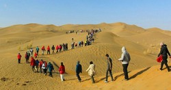 Holidaymakers hike across a desert route in Sistan-Baluchestan province, southeast Iran.