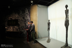 "Swiss Ambassador Markus Leitner (L) speaks during the unveiling ceremony of Alberto Giacometti's statues, ""Walking Man 1"" and ""Standing Woman 1"", at the Tehran Museum of Contemporary Art on February 2"