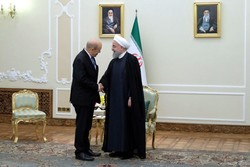 President Rouhani receives France's Le Drian in Tehran