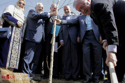 a ceremony for planting trees as a sign of friendship and peace with diplomatic delegations in attendance