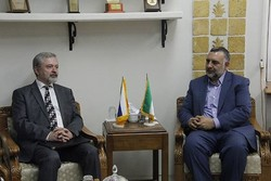 Slovak Ambassador Lubomir Golian (L) meets the Iranian Deputy Culture Minister for Cultural Affairs, Mohsen Javadi, in Tehran.