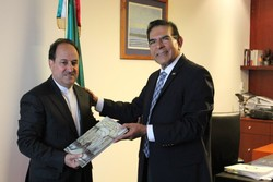 Iran's Ambassador to Mexico Mohammad Taqi Hosseini (L) meets the president of Mexico's health commission Senator Salvador López Brito