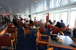 Holiday makers enjoy cruising on Iranian southern waters